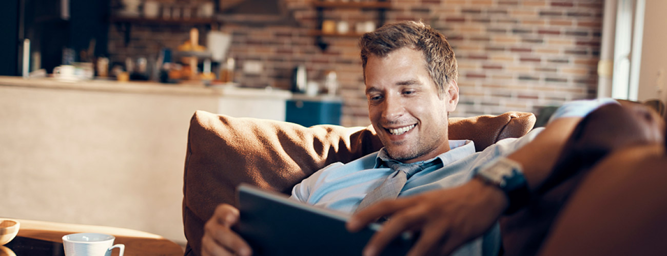 Man using tablet and smiling